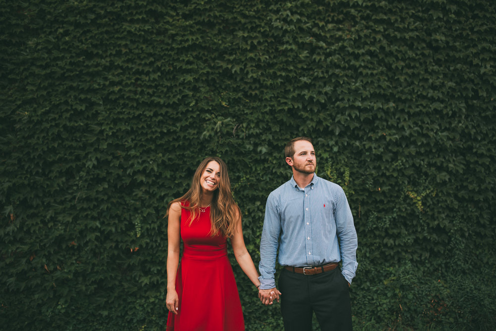 engagement photos in front of ivy wall in kansas city