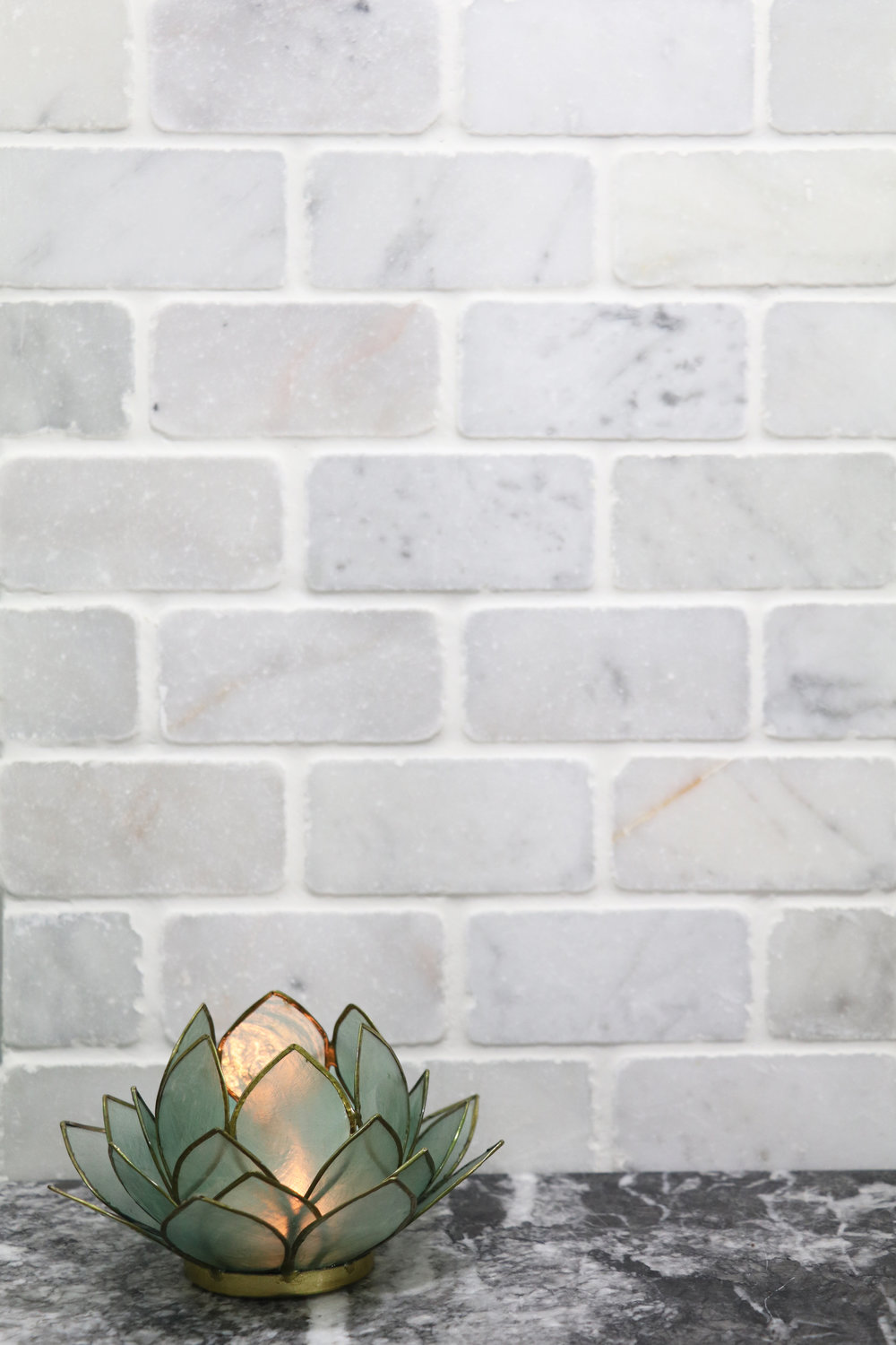 2x4 tumbled antique carrara brick inspo.jpg