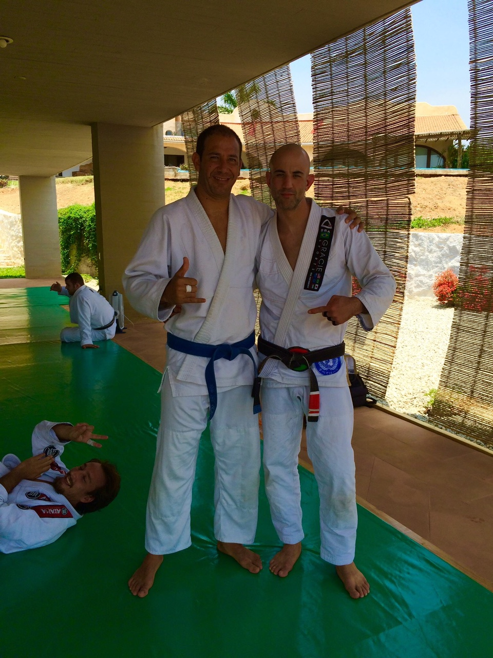Adrian received his blue belt from Brad at the last day of camp!