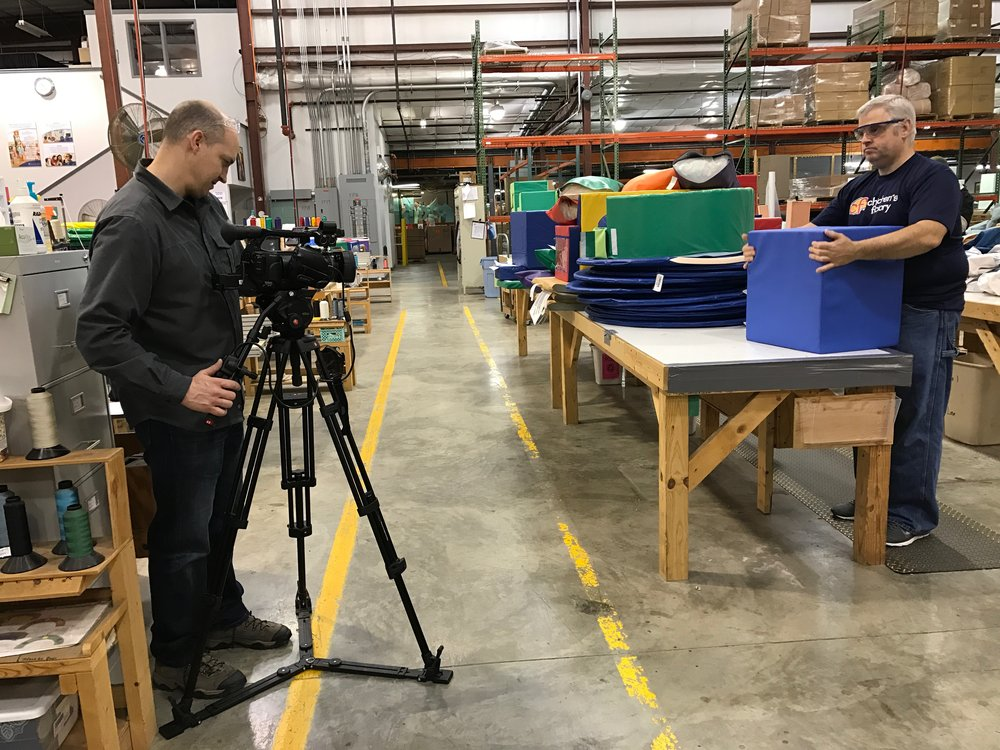 LTM at Children's Toy Factory filming the block stuffing process.