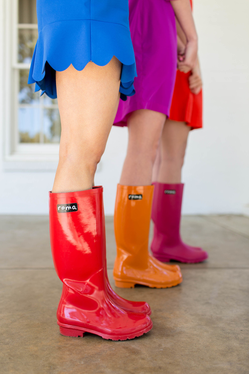 Boots Provided by Roma Boots, a one for one company that uses fashion to give poverty the boot. This company is near and dear to our hearts.Boots shown in Glossy Red, Glossy Orange, and Matte Magenta.