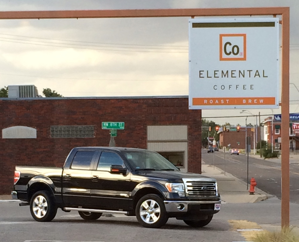 There she is: Our Black Beauty. We stopped by Elemental for a celebratory cup of coffee