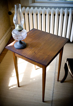 "Emily Dickinson wrote nearly 2,000 poems on this desk. Emily's niece described it as Emily's ""only writing desk: a table, 18-inches square, with a drawer deep enough to take in her ink bottle, paper and pen. It was placed in the corner by the window facing west."""