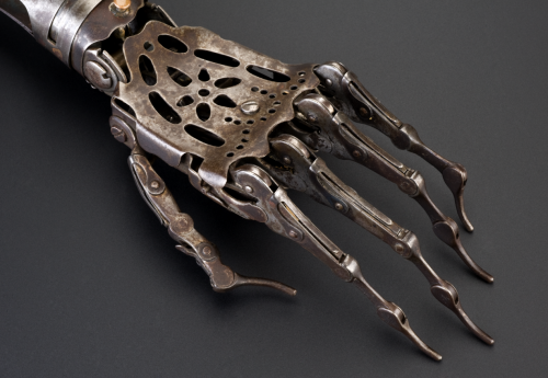 "liquidnight :     Detail of an artificial left arm, Europe, 1850-1910   ""Made from steel and brass, this unusual prosthetic arm articulates in a number of ways. The elbow joint can be moved by releasing a spring, whereas the top joint of the wrist allows a degree of rotation and an up-and-down motion. The fingers can also curl up and straighten out. The leather upper arm piece is used to fix the prosthesis to the remaining upper arm. The rather sinister appearance of the hand suggests the wearer may have disguised it with a glove. Among the most common causes of amputation throughout the 1800s were injuries received as a result of warfare.""   [via  The Science Museum   where you'll find two more images of thise beautiful prosthesis ]     I find this to be sufficiently creepy."