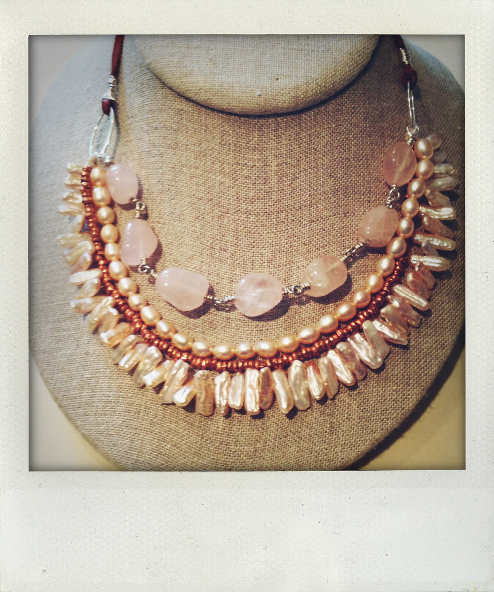 4 strand necklace with biwi pearls, copper trade beads, pink freshwater pearls, and rose quartz. It's pink, but it's tough!