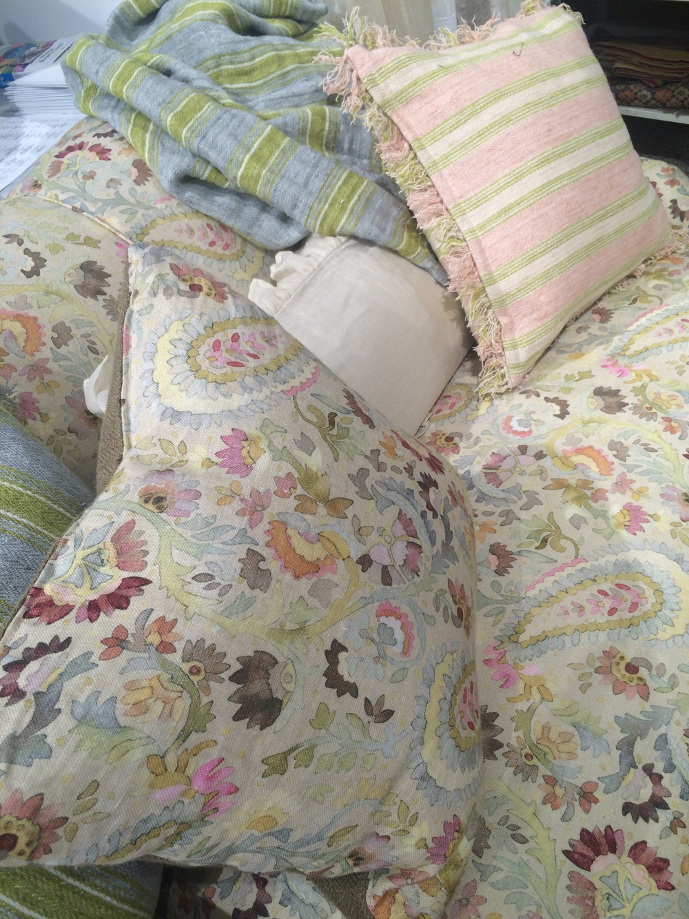 These pretty throws and pillows have us dreaming of Spring!