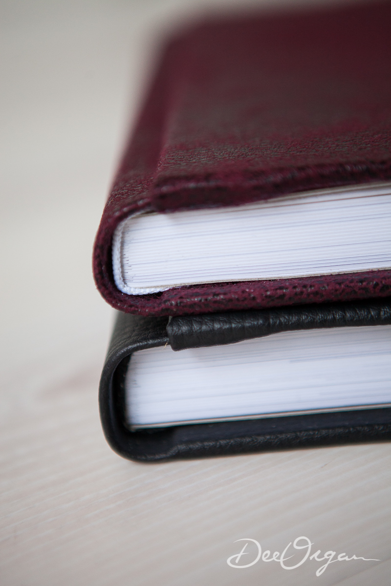 Finished with a Burgundy Suede hard cover