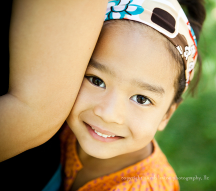 Portrait of girl holding her mother, Santa Fe, New Mexico