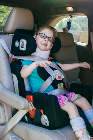 Special Needs Car Seat vs. Typical Car Seat — Made of Gray
