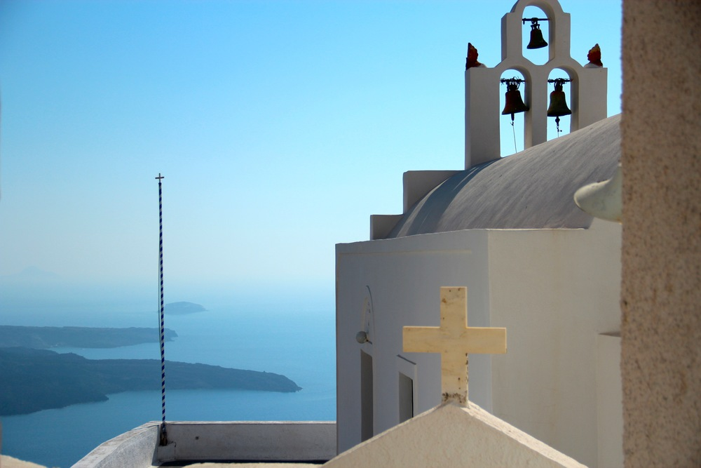 """On the hike from Fira to Oia, you'll pass several pockets of resort towns, go over a few rock-filled hills, and occasionally lose the """"path."""" Tip: Just follow the coast and keep going north."""