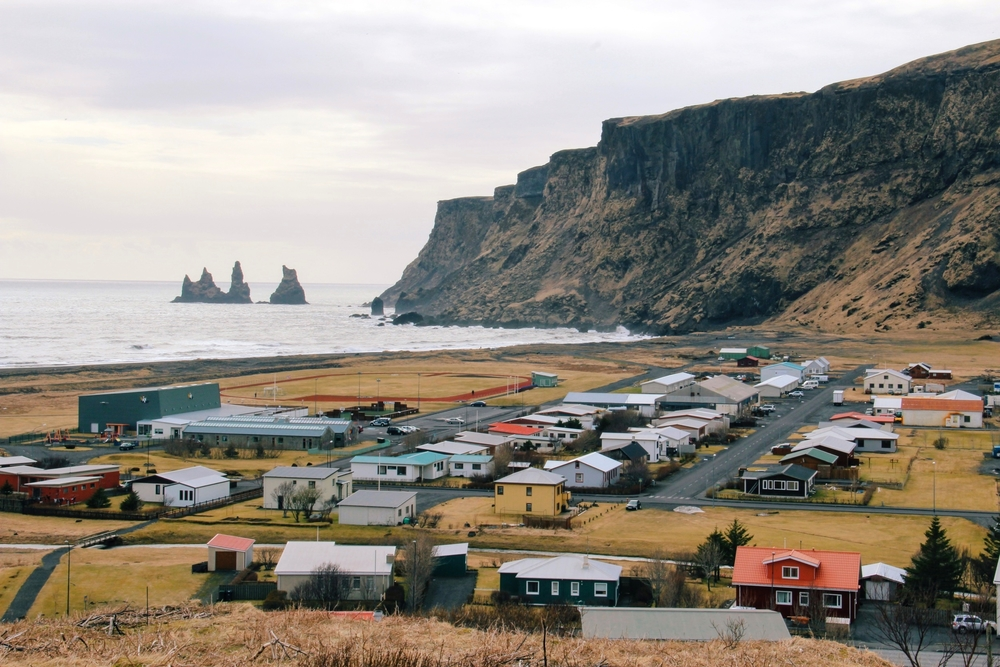 Iceland's southern town of Vik is surrounded by scenic cliffs and black sand beaches.