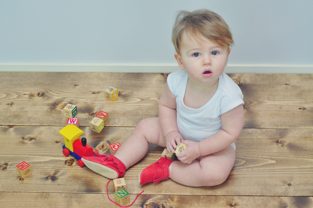 Theo sporting the Cardinal Mocs from Minimoc!