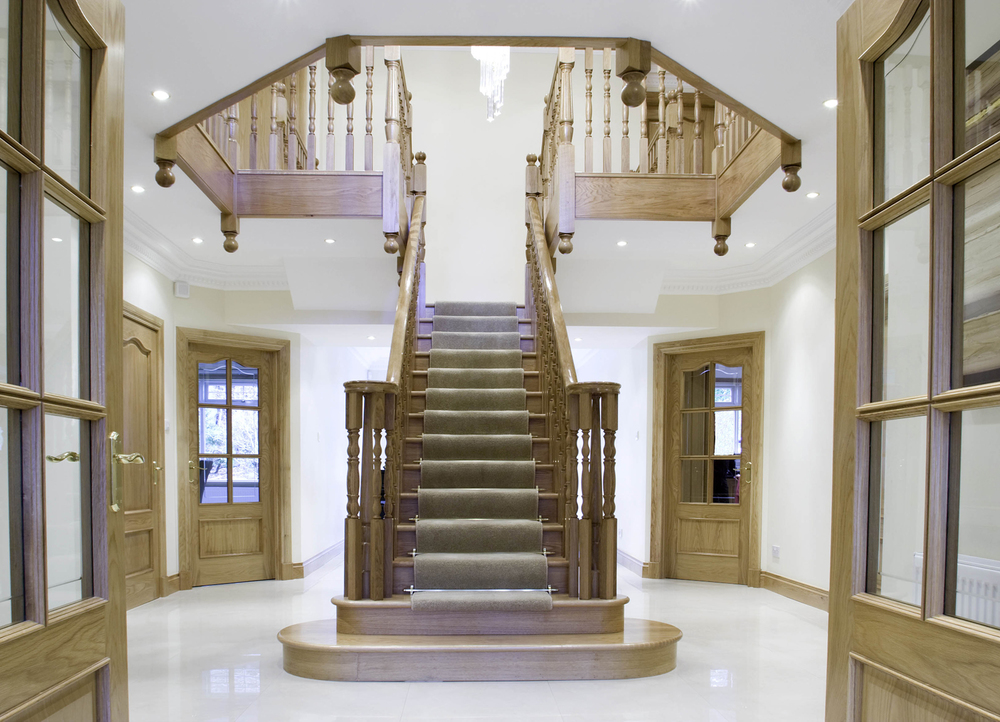 www.stockwell-ltd.co.uk   Cut-stringer T-shaped oak stair with feature curtail platform, curtail step and volute handrail fittings.
