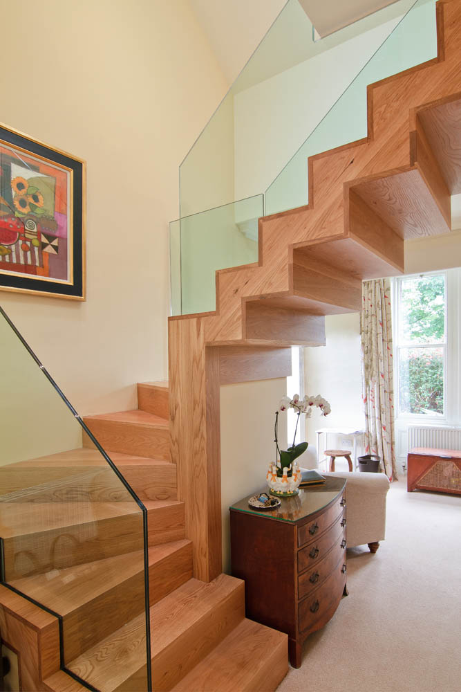 www.stockwell-ltd.co.uk   Solid American white oak timber sawtooth winder stair with inserted glass balustrading.