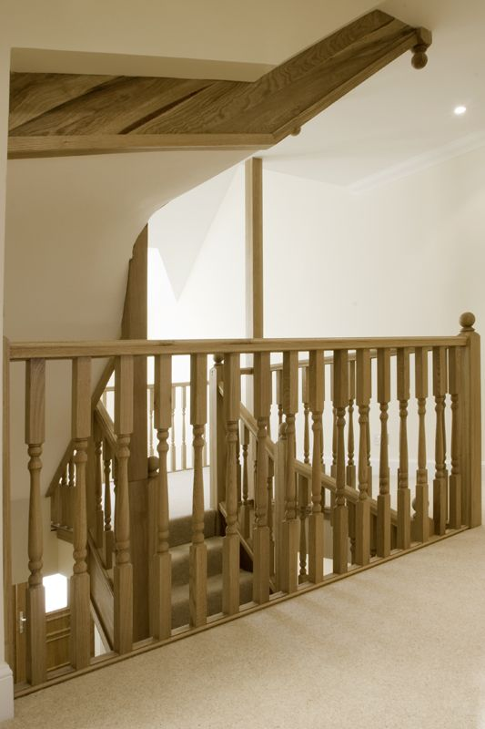 www.stockwell-ltd.co.uk   American white oak winder staircases serving a 3 storey townhouse with square newel posts and turned spindles.