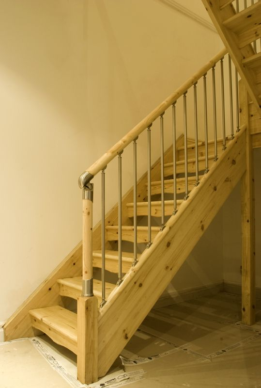 www.stockwell-ltd.co.uk   Red pine open-rise, 2-part dogleg flight stair with Richard Burbidge chrome fusion balustrade.