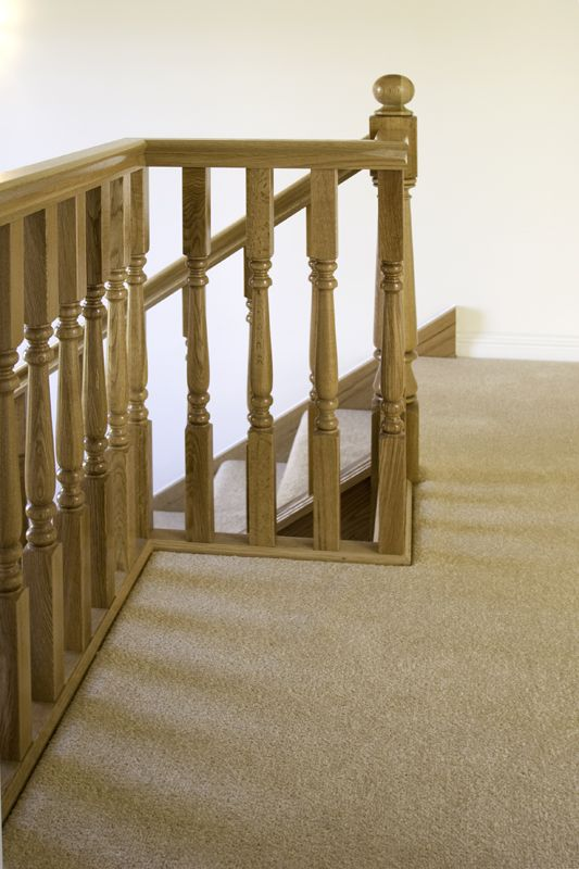 www.stockwell-ltd.co.uk   Oak 3-part dogleg stair with 2 quarter landings and turned classic posts and spindles.