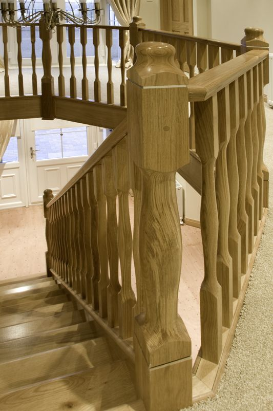 www.stockwell-ltd.co.uk   Solid American white oak straight flight stair with curtail-step and hexagonal landing incorporating Modus balustrade by Clive Durose.