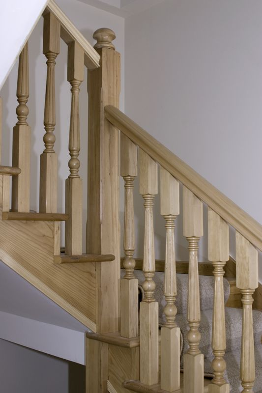 www.stockwell-ltd.co.uk   Hemlock lower and upper 3-part dogleg stair featuring chamfered 120mm newel posts and traditional turned 56mm spindles.