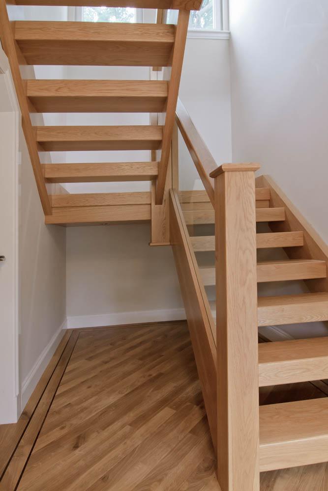 www.stockwell-ltd.co.uk   Sleeper tread, open-rise dog-leg stair in American white oak.