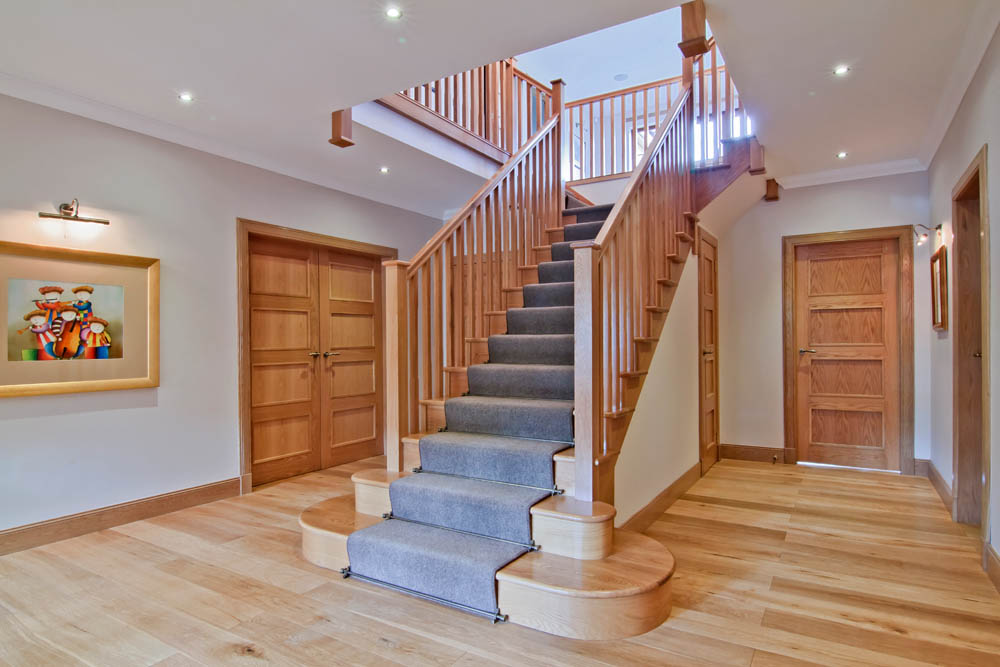 www.stockwell-ltd.co.uk   T-Shape cut-stringer oak stair with feature curtail platform, curtail step, square newels and chamfered spindles.