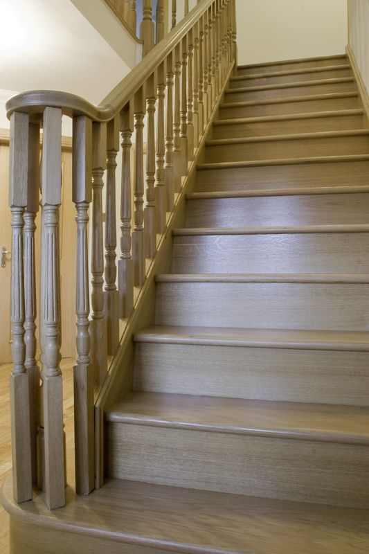 www.stockwell-ltd.co.uk   Clive Durose fluted-oak balustrade on a straight-flight staircase and landing with volute fitting and feature curtail step.