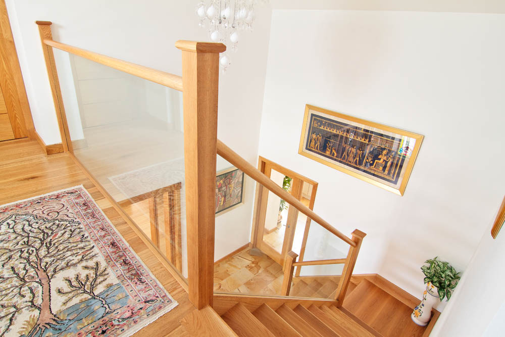 www.stockwell-ltd.co.uk   Open riser American white oak and glass staircase with sleeper-style treads and feature bottom bullnose step.