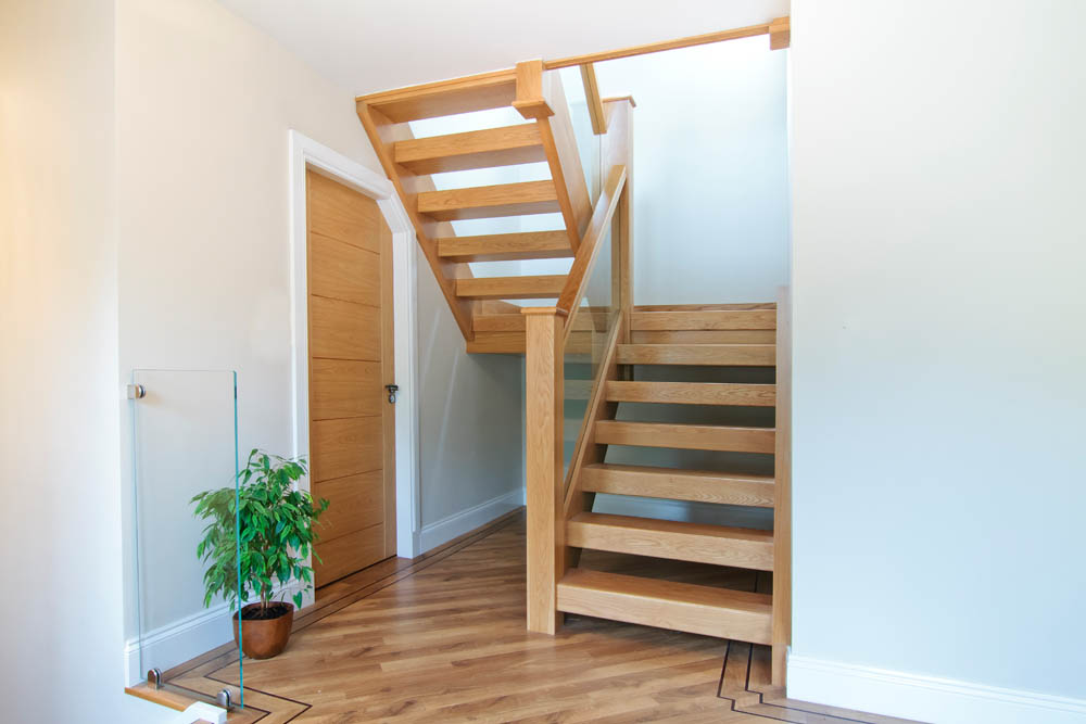www.stockwell-ltd.co.uk   Sleeper tread, open-rise dog-leg stair in American white oak.
