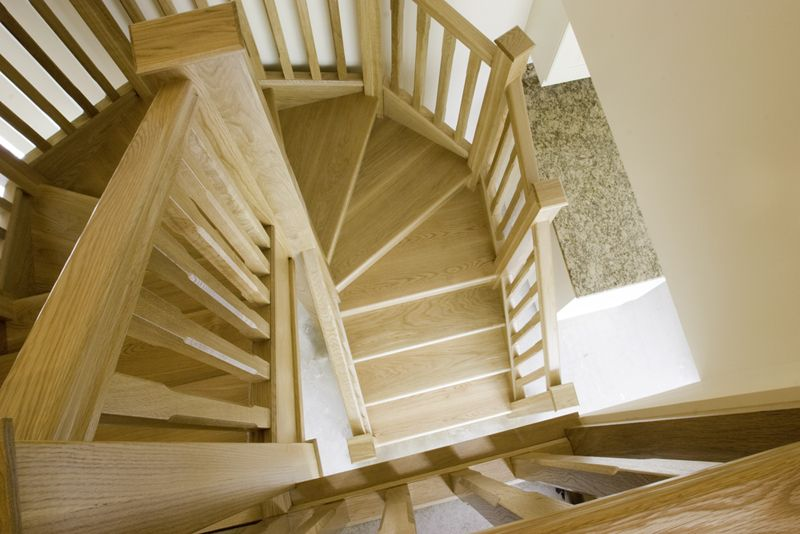 www.stockwell-ltd.co.uk   Hexagonal 6 kite mid-winder oak staircase with square and chamfered balustrade.