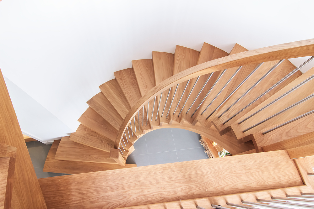 www.stockwell-ltd.co.uk   Cut-stringer curved stair and straight flight cut-stringer staircase   in American white oak   with brushed nickel spindles and finished with an osmo oil.