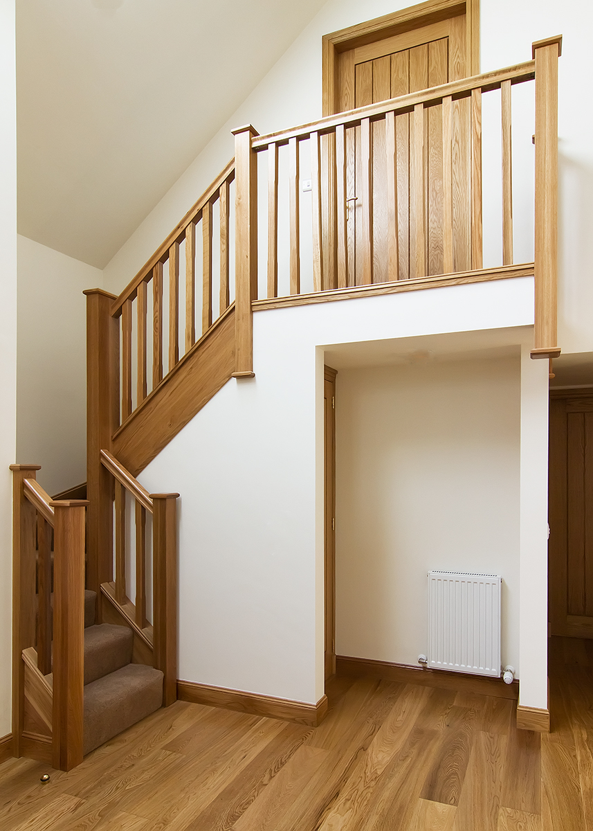 www.stockwell-ltd.co.uk    American white oak 4 kite mid-winder flight   stairs   with square newels, low-profile handrail and baserail, stop-chamfered spindles and flat newel caps.