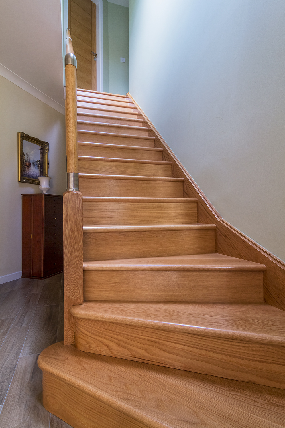 www.stockwell-ltd.co.uk   3 kite bottom winder oak staircase with feature kite bullnose steps, Richard Burbidge Fusion newels, brushed nickel Fusion stair components and with Richard Burbidge Fusion glass panels.