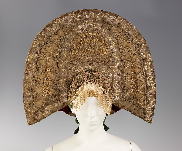 "The  traditional Russian headdress called a ""kokoshnik""."