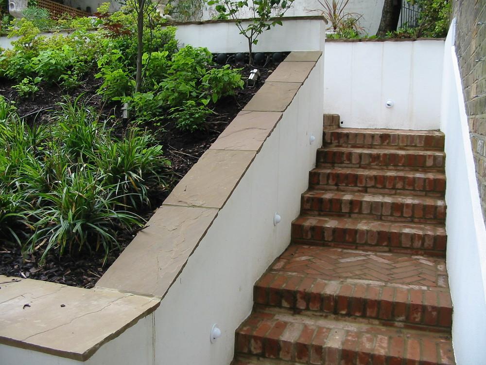 Brick steps in London garden.JPG