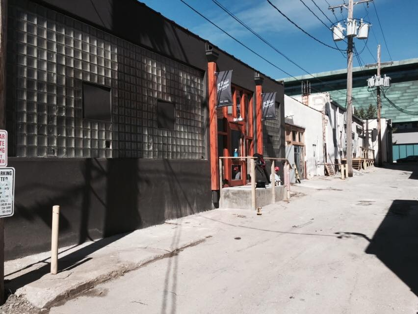 Entrance to The Vow Exchange located in alley between McGee & Oak Street