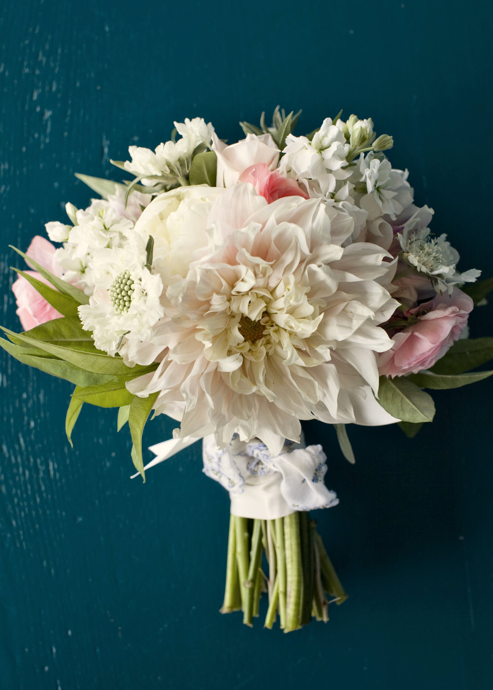 COUPLE'S 2 BOUQUETSET - $300INCLUDES:2 BRIDE'S BOUQUETS• 1 Premium Flower Selection• Assorted flowers with greenery in choice of 2 colors• Hand tied design with ribbon detailing• Delivery to event site (within Kansas City metro)