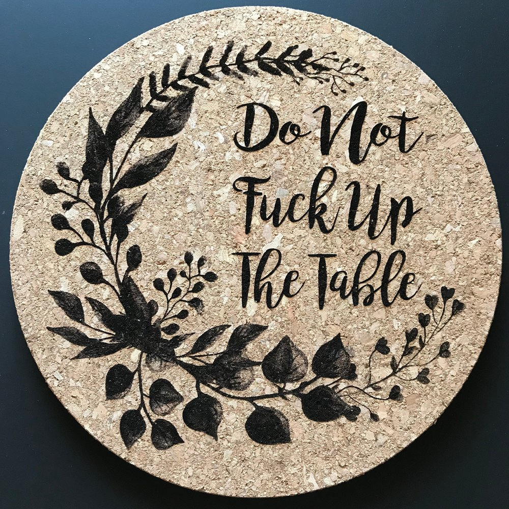 5. Guest Table Decor - Remind your messier guests to mind their manners with this cork table topper.