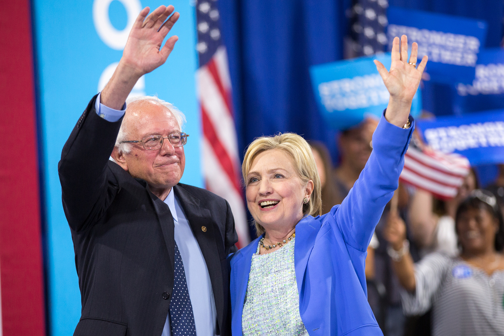 July 12, 2016 - Bernie Sanders and Hillary Clinton wave to the crowd at a rally in Portsmouth, New Hampshire where Sanders endorsed Clinton's run for President.