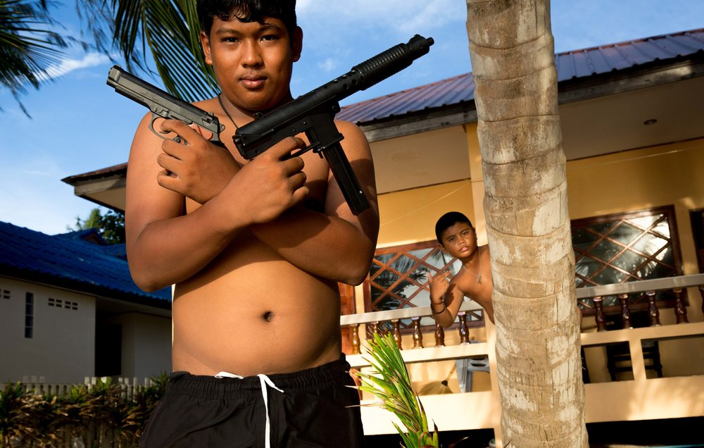 Sep. 13, 2017 - Two boys play with with toy guns In Koh Tao, Thailand.