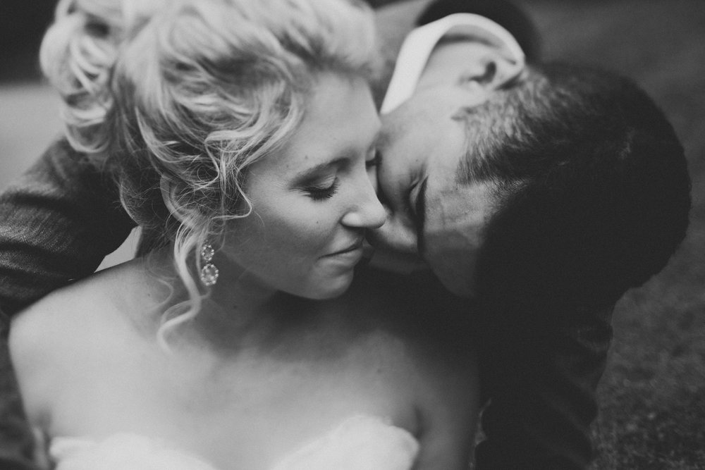Black and white couple of portrait on their wedding day by Amelia Fletcher.