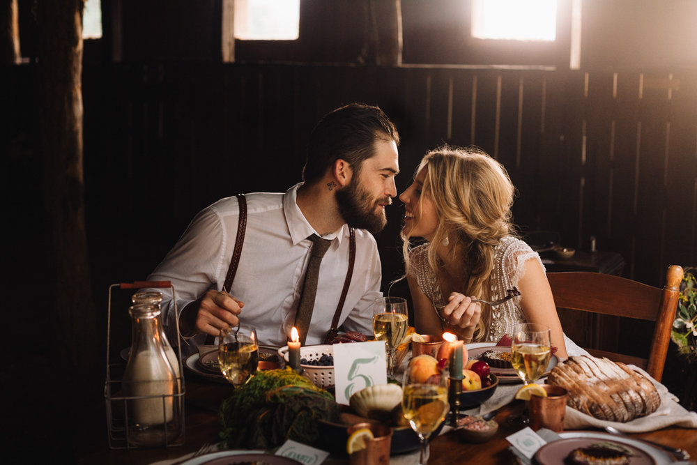 Couple shares an intimate moment during dinner on their wedding day in Asheville, North Carolina.