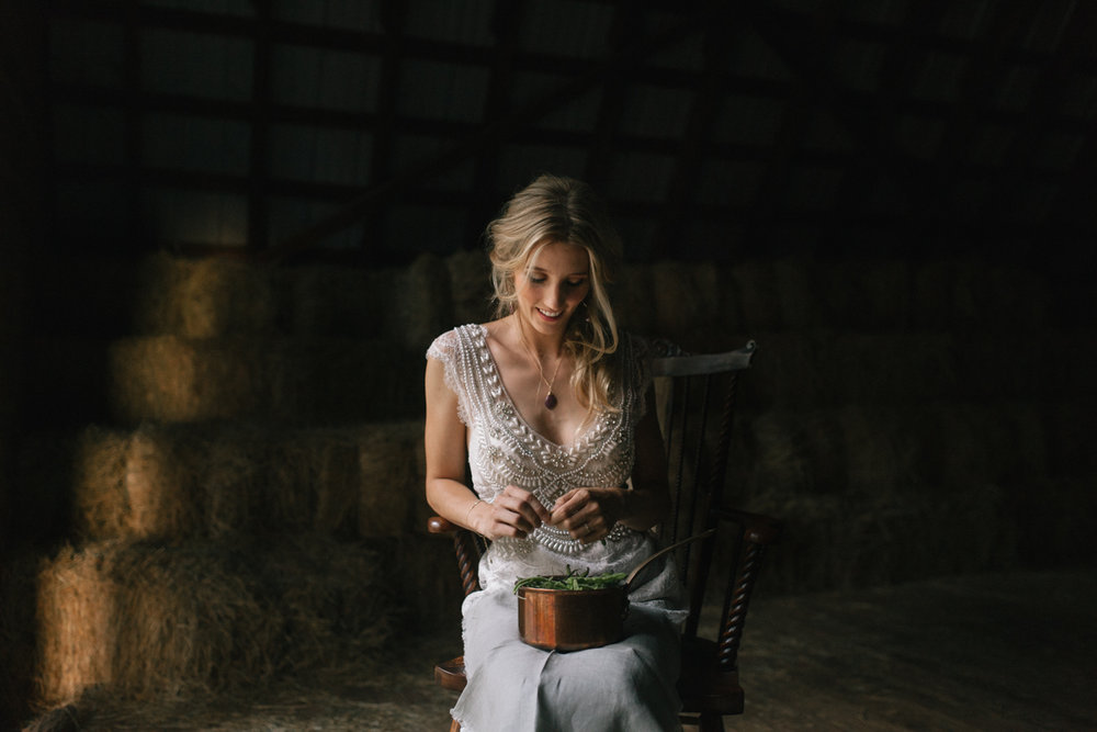 Bride in barn.