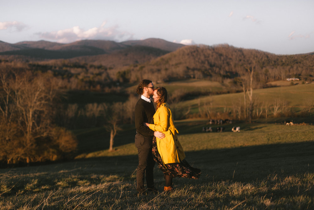 Couple embraces on a mountain in western North Carolina.