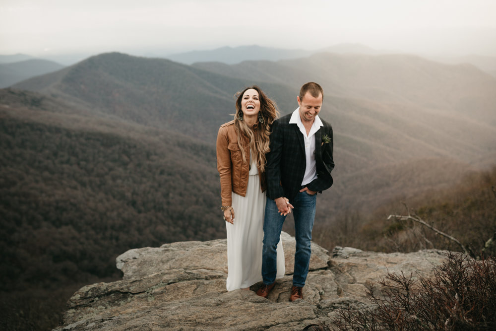Newly married couple on the side of a mountain in Asheville, North Carolina.