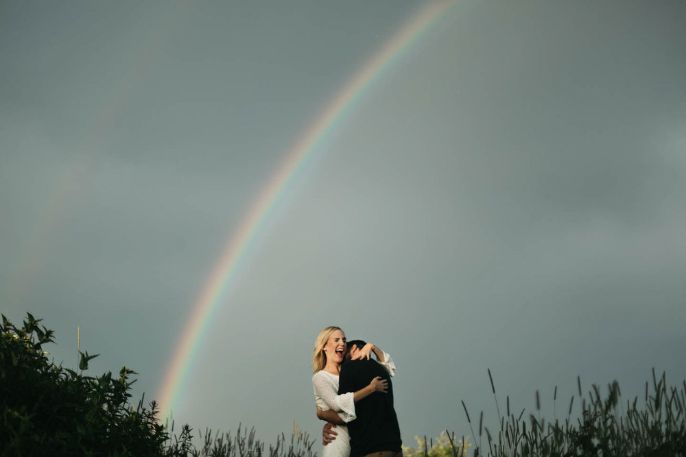 Couple under a rainbow at Black Balsam Knob in North Carolina.