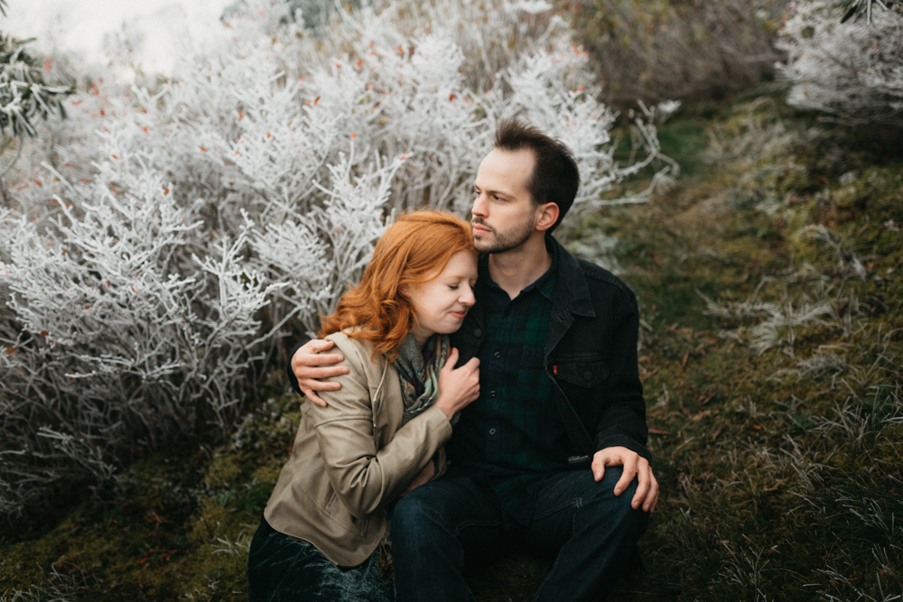 Couple embraces during a winter engagement shoot on the Blue Ridge Parkway.