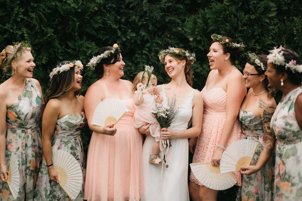 Bridesmaids in floral mix and match dresses at a wedding at Lake Lure Inn.