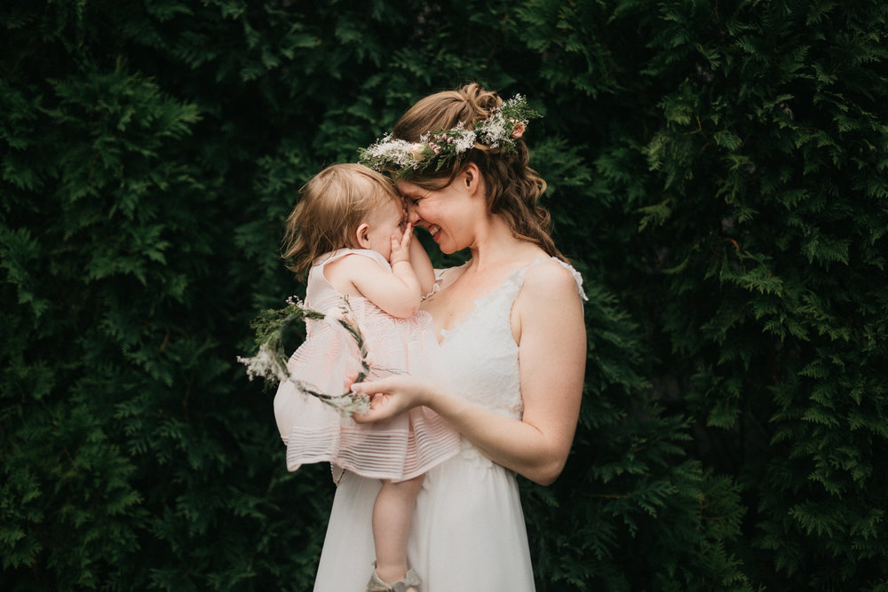 A mother and daughter hug at a destination wedding in the mountains of North Carolina.