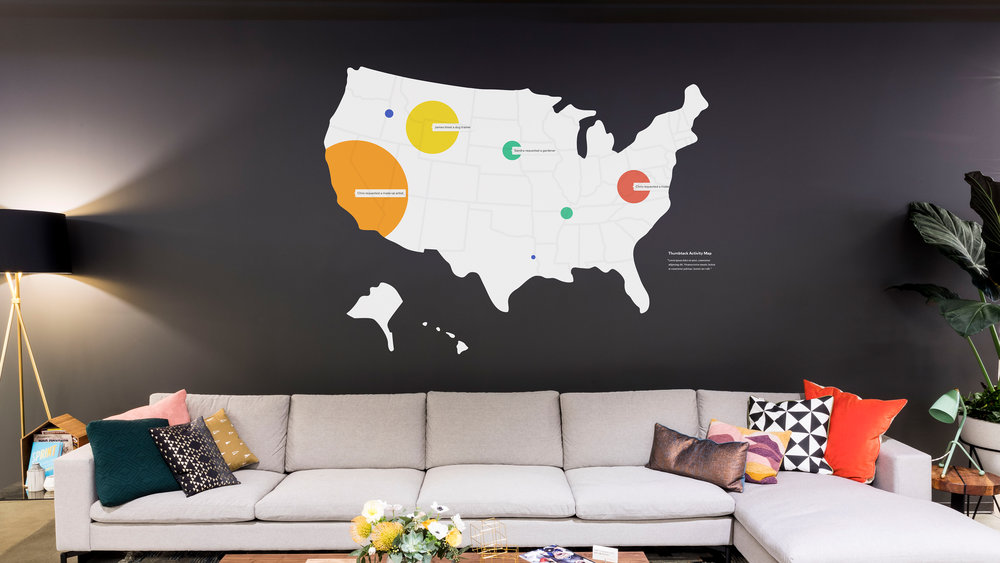 Our lobby features a masked digital projection map that showcases live data of Thumbtack jobs happening across the nation.