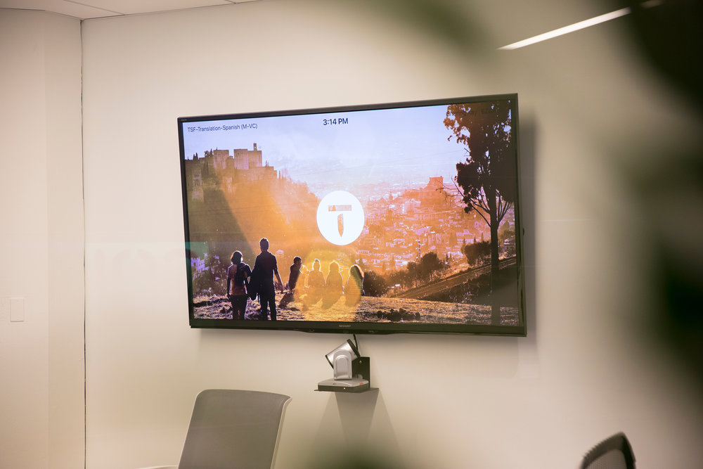For rooms that have video conferencing, we created custom wallpapers specific to each room. This provides even more visual cues to help people find rooms faster, and also provides a bit of wanderlust as they wait for their meeting to begin.